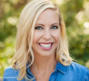 stock image of a woman smiling for a blog about how to fix a chipped tooth with cosmetic dentistry treatments in Charlotte, NC
