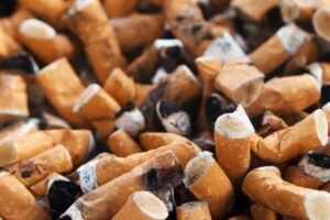 image of cigarettes for blog about how smoking and genetics affect the success of your dental treatments in Charlotte