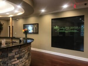Photo of the reception desk at Charlotte Center for cosmetic dentistry in Charlotte, NC.