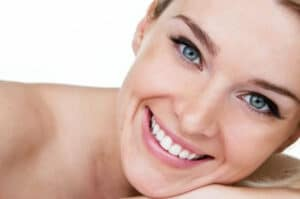 stock image of a woman smiling on page about cosmetic dentistry treatments in Charlotte